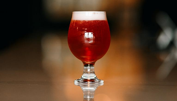 Image of beer in a brandy snifter