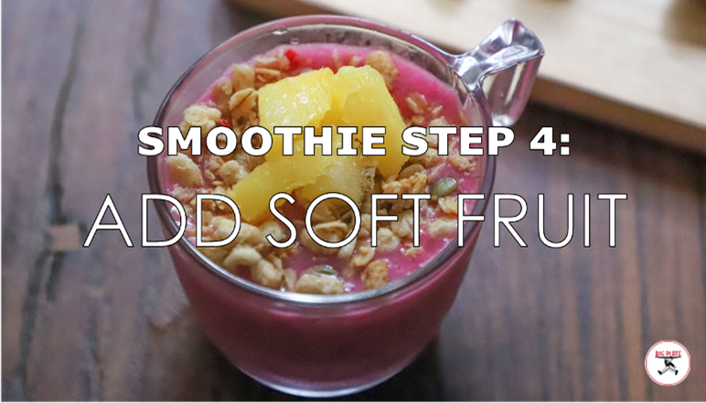 """Image of a smoothie topped with oats and pineapple with the text """"Smoothie Step 4: Add Soft Fruit"""""""