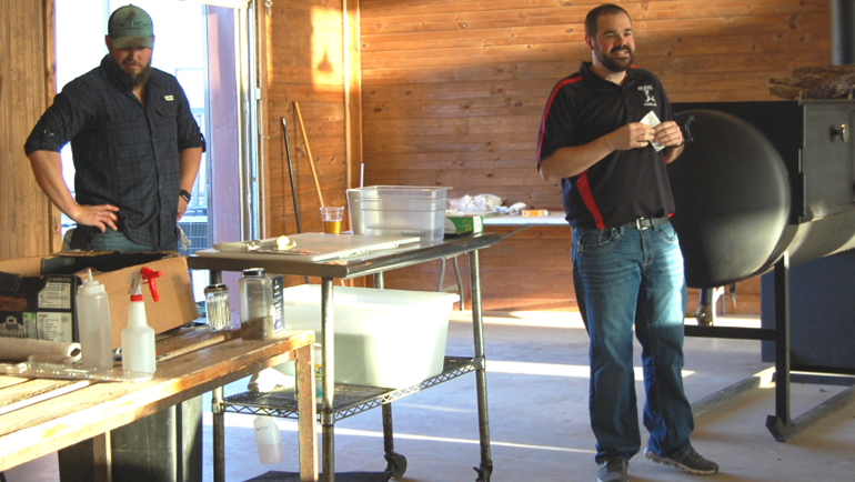 Image of Arnis Robbins, Pitmaster and Owner of Evie Maes Pit Barbecue and Matt Nuckolls, Manager of Big Plate Restaurant Supply