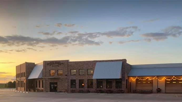 Image of Evie Mae's restaurant at sunset