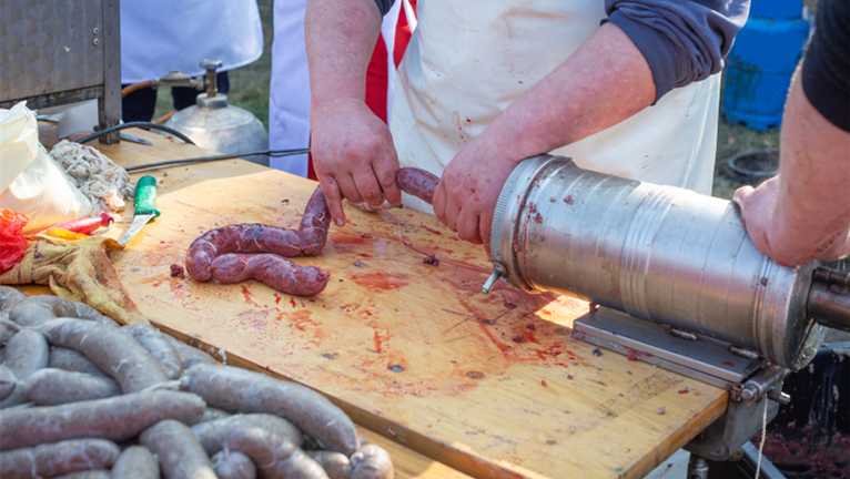 Image of sausage stuffing with natural casing