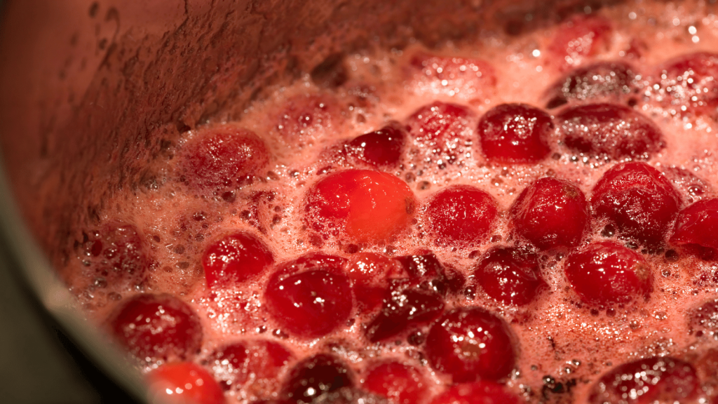 Crabapples boiling in a pot, representing step 2 of how to make crabapple butter: boil the crabapples.