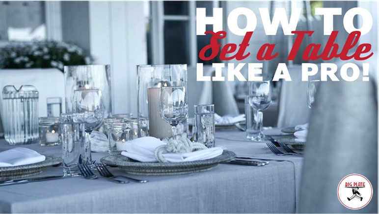 """Photo of a beautiful table in grays, whites, and crystal wine glasses on a gray linen tablecloth. The title """"How to Set a Table Like a Pro"""" is superimposed over the photo."""
